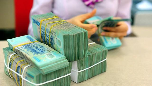 Dồn ép cuối năm, ngân hàng liên tiếp tăng lãi suất - Ảnh 1.