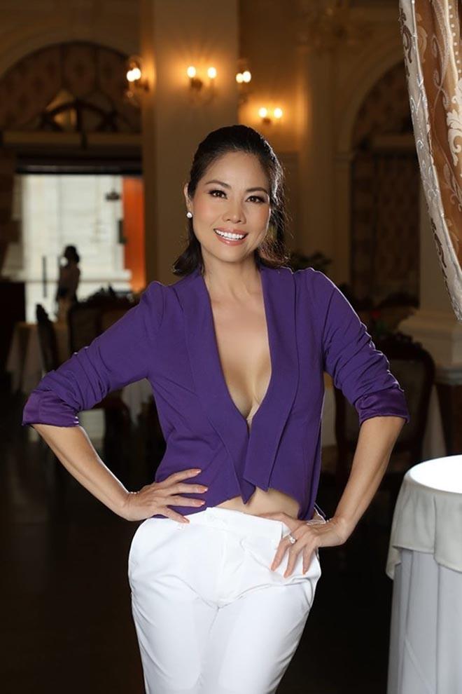 Nữ ca sĩ Việt từng có 3 đời chồng tung loạt ảnh bikini gợi cảm ở tuổi 46 - Ảnh 12.