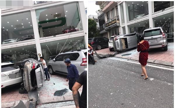 Hà Nội: Xe Vios đâm vỡ cửa kính, phi từ tầng 2 xuống khiến 2 ô tô gặp họa