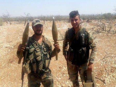 Chùm ảnh quân Assad đánh cho kẻ thù thua tan tác ở chiến trường khốc liệt Syria - Ảnh 3.