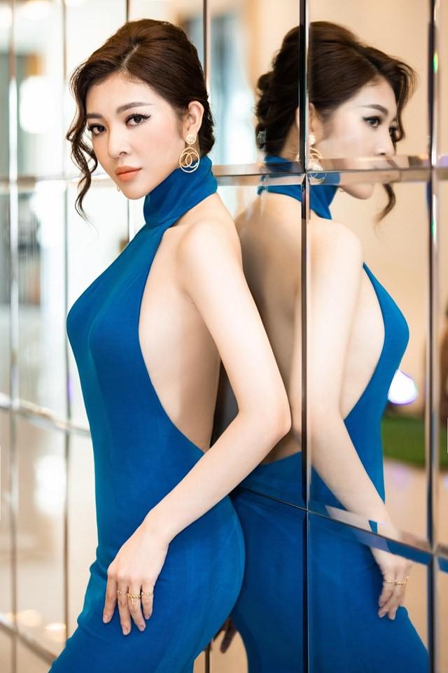 Hoa hậu Thiên Hương khoe da trắng, lưng trần quyến rũ - Ảnh 1.