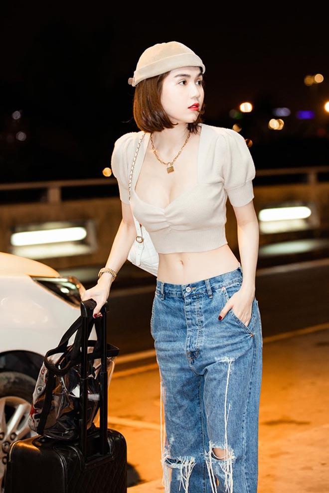 Ngọc Trinh mặc nội y táo bạo, xách túi hiệu đắt đỏ trên đường phố nước ngoài - Ảnh 7.