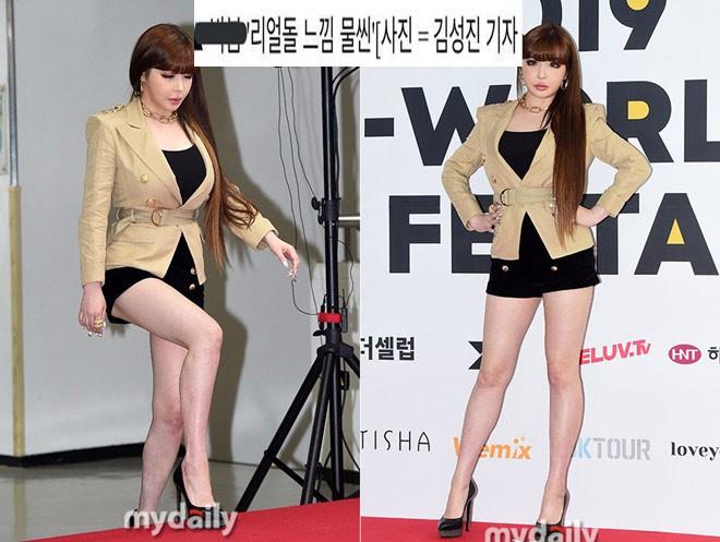 Nữ ca sĩ nổi tiếng bị báo chí Hàn miêu tả như búp bê tình dục gây phẫn nộ - Ảnh 1.