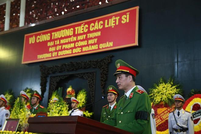 Nghẹn ngào tiễn đưa 3 liệt sĩ hy sinh tại Đồng Tâm - Ảnh 1.