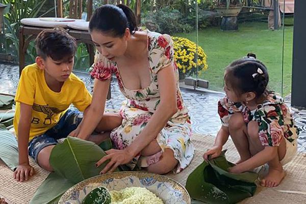 Giỏi giang trên thương trường, lộng lẫy ở sân khấu, Hoa hậu Hà Kiều Anh vẫn biết gói hơn 100 cái bánh chưng đón Tết - Ảnh 2.