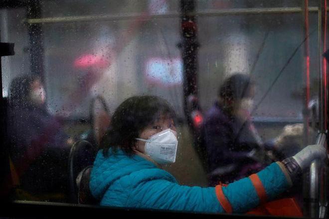 Cảnh tượng hiếm thấy: Hàng triệu người trở lại làm việc nhưng các siêu đô thị Trung Quốc vẫn chìm trong hôn mê vì virus corona - Ảnh 27.