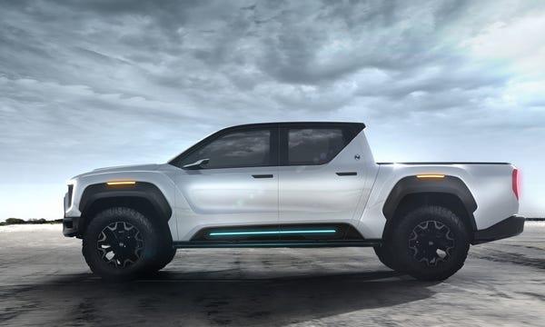 Xe bán tải điện đối thủ của Tesla Cybertruck lộ diện: trâu hơn, thiết kế nội thất như xe tương lai - Ảnh 2.