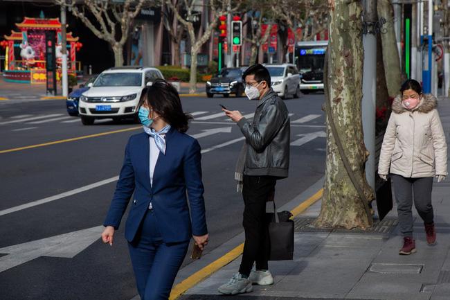 Sau khi tan hoang vì corona, nhiều thành phố lớn tại Trung Quốc bắt đầu hồi sinh - ảnh 2