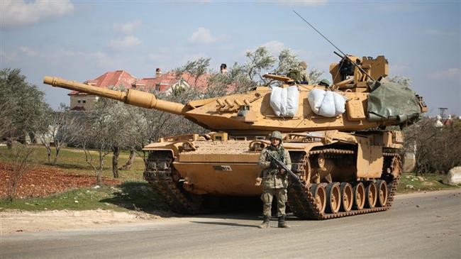 Thổ Nhĩ Kỳ bị QĐ Syria vây đánh tứ phía: Xe tăng, xe bọc thép liên tiếp cháy rụi - Ảnh 1.