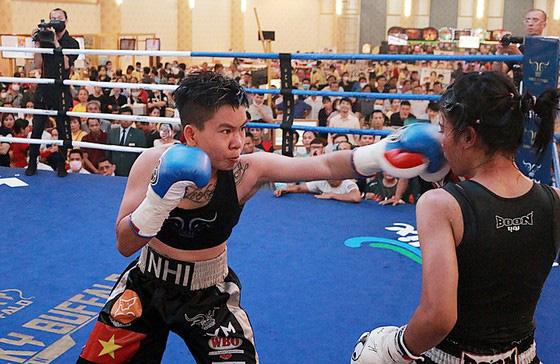 Thu Nhi trở thành nữ võ sĩ Việt Nam đầu tiên đoạt đai vô địch WBO châu Á - Ảnh 2.