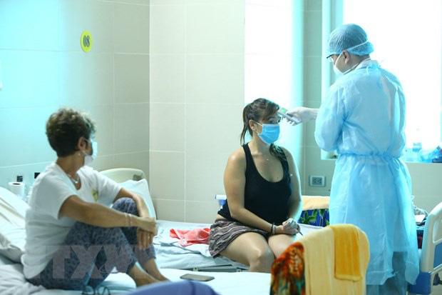 [Dịch Covid-19 ngày 23/3]: Hà Nội lập cơ sở cách ly y tế cho người nước ngoài tự nguyện trả phí - Đề xuất không cách ly người Việt tại khách sạn  - Ảnh 1.
