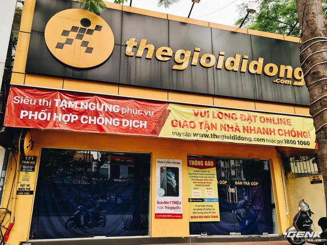 Cửa hàng kinh doanh điện thoại lớn nhỏ đóng cửa vì dịch, chuyển sang bán online - Ảnh 1.