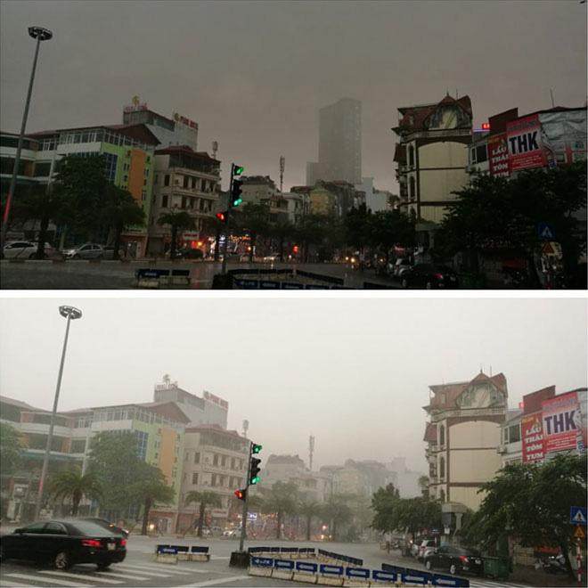 HN: Người đi đường hốt hoảng vì mưa lớn bất ngờ, 1h chiều trời đã tối sầm - Ảnh 1.