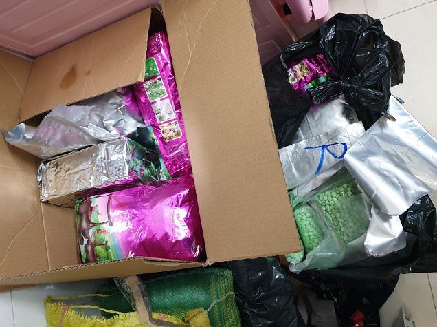 Phá đường dây ma tuý từ Campuchia về Sài Gòn thu gần 15kg ma tuý và hơn 71 ngàn viên thuốc lắc - Ảnh 1.