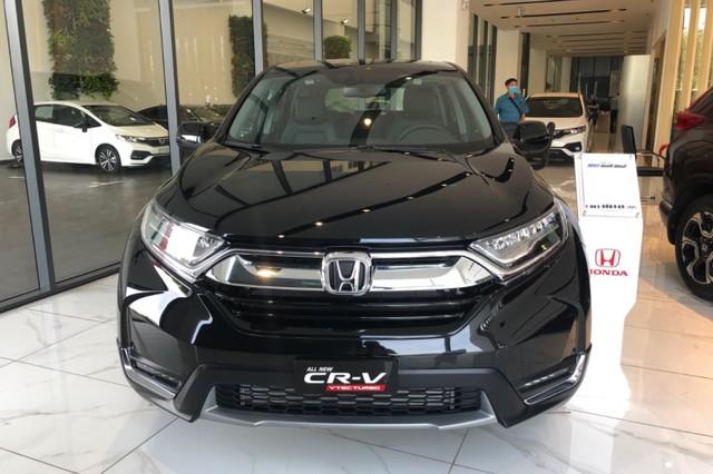 Đại lý giảm giá dọn kho Honda CR-V 'lô nhập cuối', dọn đường chờ xe lắp ráp miễn 50% trước bạ - Ảnh 1.