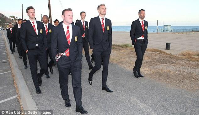Beach boys: Manchester Uniteds players took a stroll on Santa Monica beach in Los Angeles