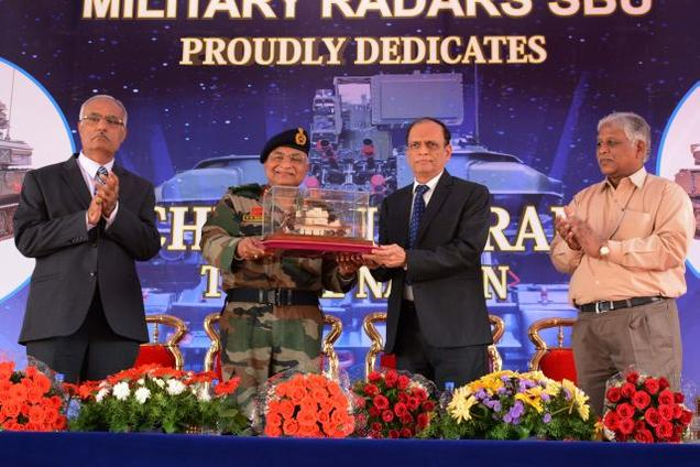 Lt Gen (Dr) V K Saxena, AVSM, VSM, Director General, Army Air Defence, receives a model of the Upgraded Shilka Weapon Systems from Mr S K Sharma, Chairman & Managing Director, BEL, in Bengaluru on Tuesday. They are flanked by Mr Manmohan Handa, Director (Bangalore Complex), BEL, and Mr R Chandrakumar, Executive Director (Military Radar), BEL.