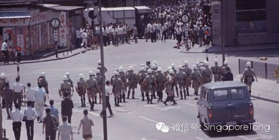 Lực lượng an ninh của chính quyền Anh thuộc trấn áp một cuộc vận động của quần chúng tại Hồng Kông. Ảnh: China Daily.