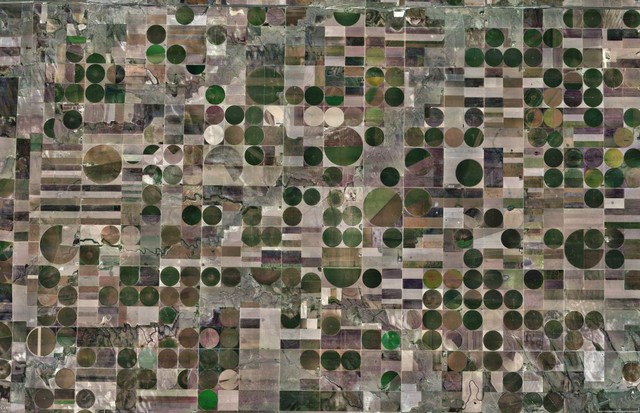 Center-pivot irrigation, a way of watering crops with sprinklers, dot the square fields in West Kansas, USA. Today, the majority of them are propelled by electric motors.