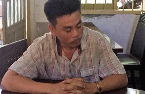 Tài xế Nguyễn Bảo Toàn tại Công an phường Tân Phú (quận 9). Ảnh: TRỌNG VINH