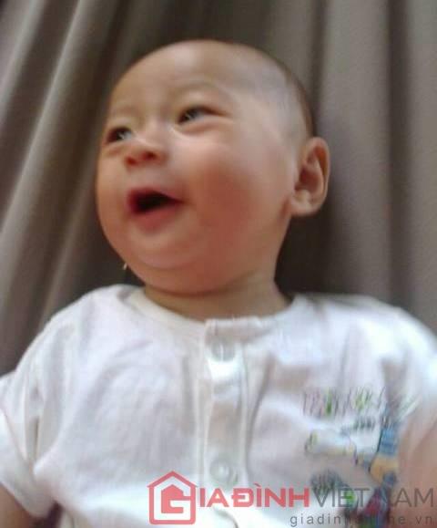Quốc Huy luôn cười tươi và kháu khỉnh