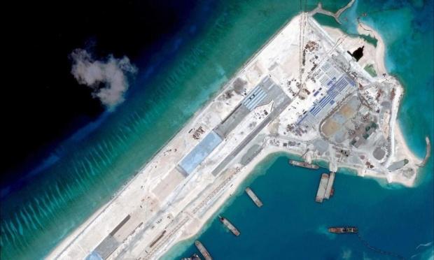 Ảnh chụp vệ tinh cho thấy hoạt động xây dựng trái phép của Trung Quốc trên Đá Chữ Thập, thuộc quần đảo Trường Sa của Việt Nam. Ảnh: AFP.
