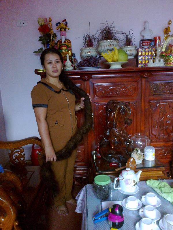 Chị Phùng Thị Mậu với mái tóc trăn đã từng là nỗi ám ảnh.