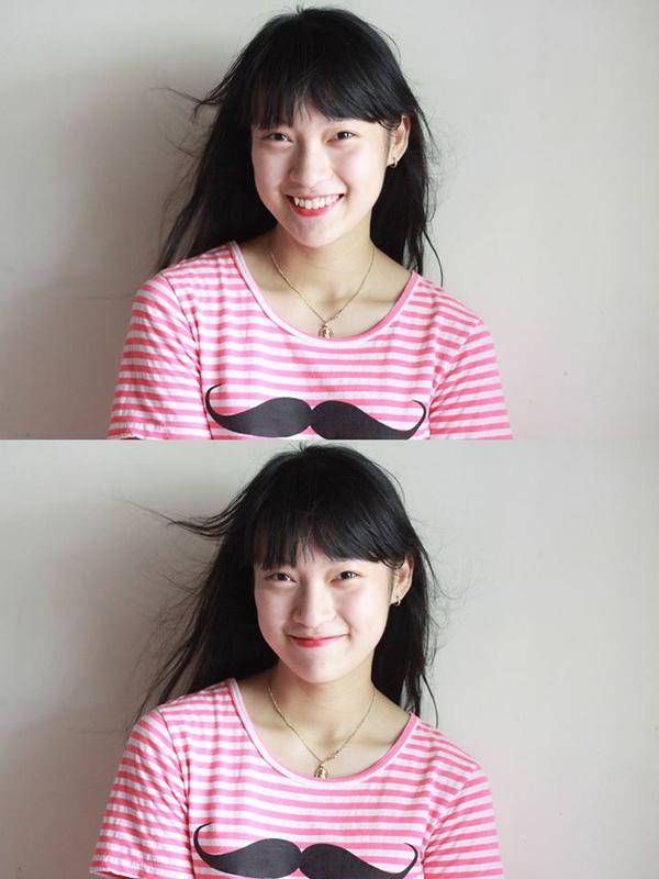 Vy có nụ cười cực tươi.