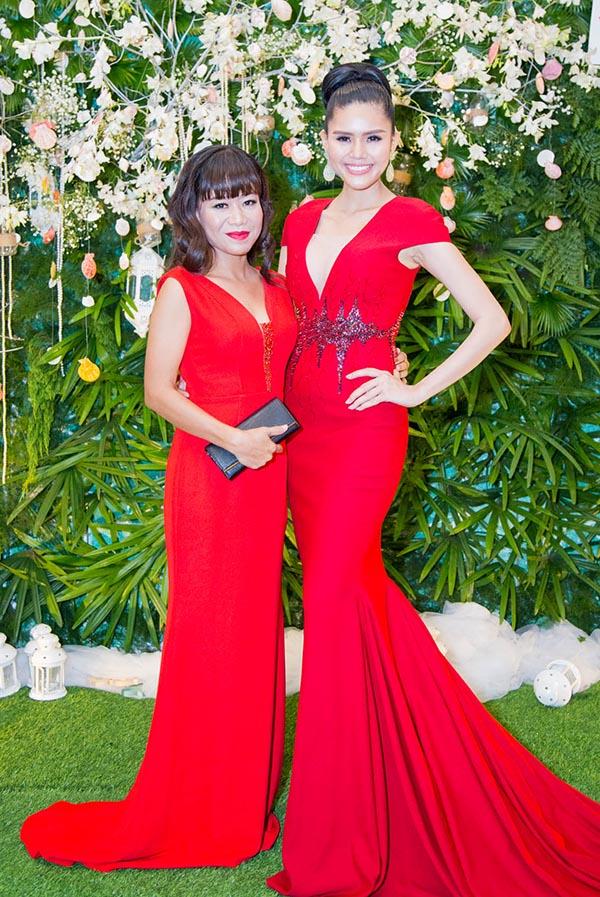 Á hậu Kim Nguyên đụng sắc đỏ với ca sĩ Thái Trân - con nuôi danh hài Hoài Linh.