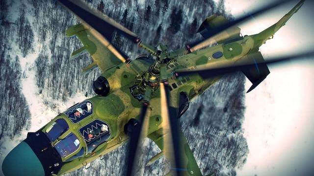 Trong ảnh là trực thăng Ka-52 bay ngang qua vùng rừng Siberia. Ka-52 là mẫu trực thăng tấn công sử dụng cánh quạt đồng trục duy nhất trên thế giới với nhiều tính năng độc đáo.  Với hàng loạt vũ khí hạng nặng và cảm biến tiên tiến, Ka-52 tiêu diệt được hầu hết các mục tiêu trên mặt đất kể cả trong điều kiện ban đêm.