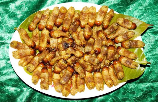 Đuông dừa nướng than hoa (Ảnh: Zing.vn)