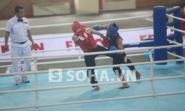 Võ Duy Thanh (Bình Định) áo xanh vượt trội Nguyễn Văn Đạo (CAND).