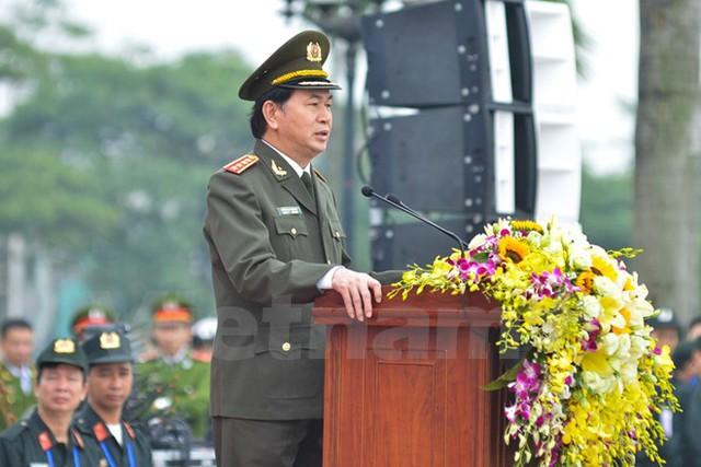 Bộ trưởng Công an Trần Đại Quang nhấn mạnh công tác bảo vệ tuyệt đối an ninh an toàn Đại hội Đảng có ý nghĩa hết sức quan trọng và góp phần thành công của Đại hội. (Ảnh: Minh Sơn/Vietnam+)