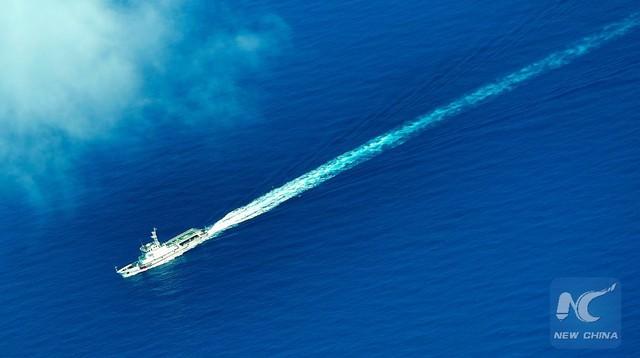 Trung Quốc cho tàu hải cảnh và tàu cá dân sự trá hình hoạt động dày đặc trên biển Đông để che mắt dư luận và phủ nhận quân sự hóa. (Ảnh minh họa: Xinhua)
