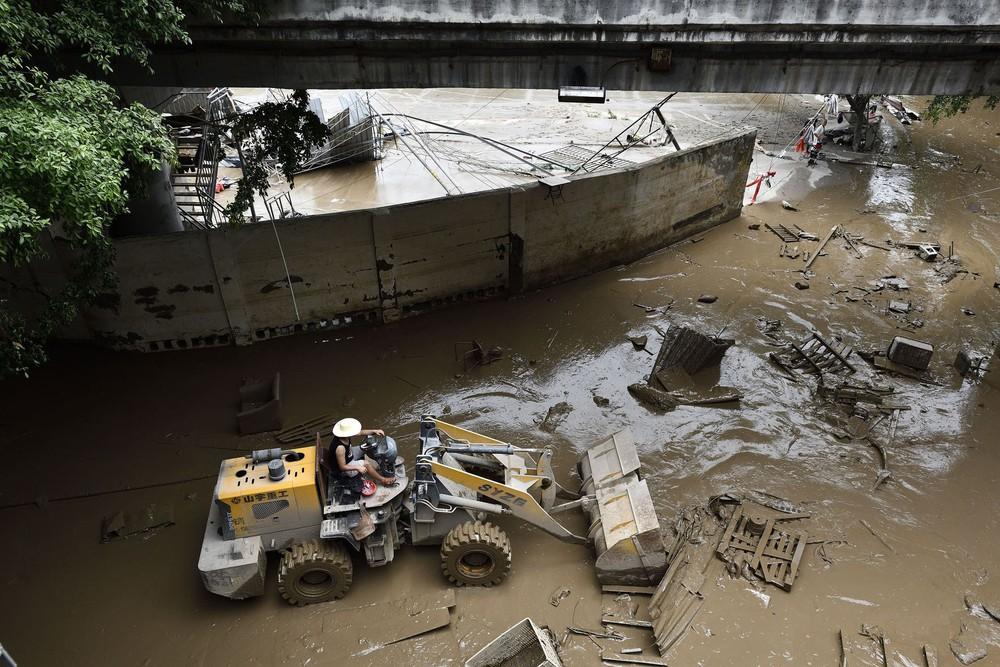 Trữ lượng hồ chứa đập Tam Hiệp gấp 2.000 lần trữ lượng nước Tây Hồ, người Trùng Khánh vất vả thu dọn tàn tích - Ảnh 8.