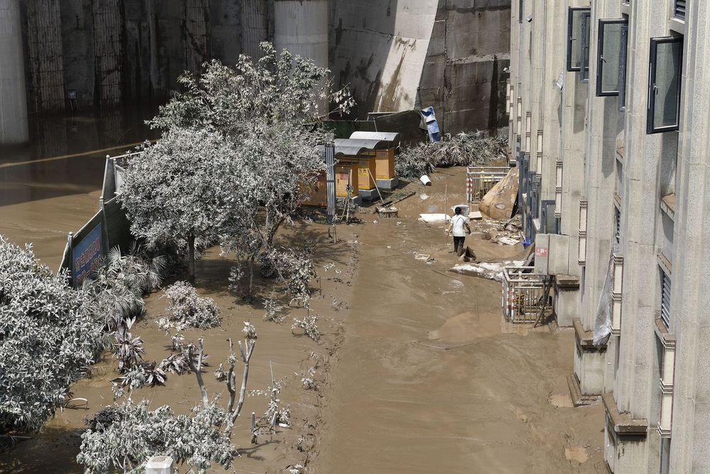 Trữ lượng hồ chứa đập Tam Hiệp gấp 2.000 lần trữ lượng nước Tây Hồ, người Trùng Khánh vất vả thu dọn tàn tích - Ảnh 11.
