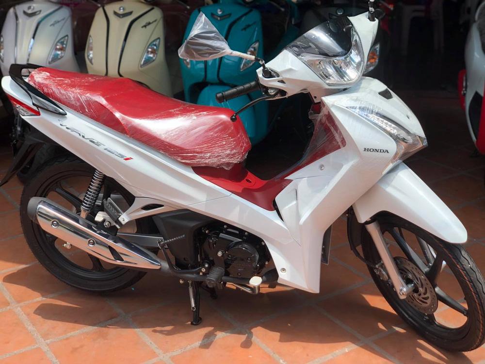 Xe máy Thái Lan tiết kiệm xăng 1,4L/100km, cốp rộng 17 lít, về Việt Nam giá bao nhiêu? - Ảnh 1.