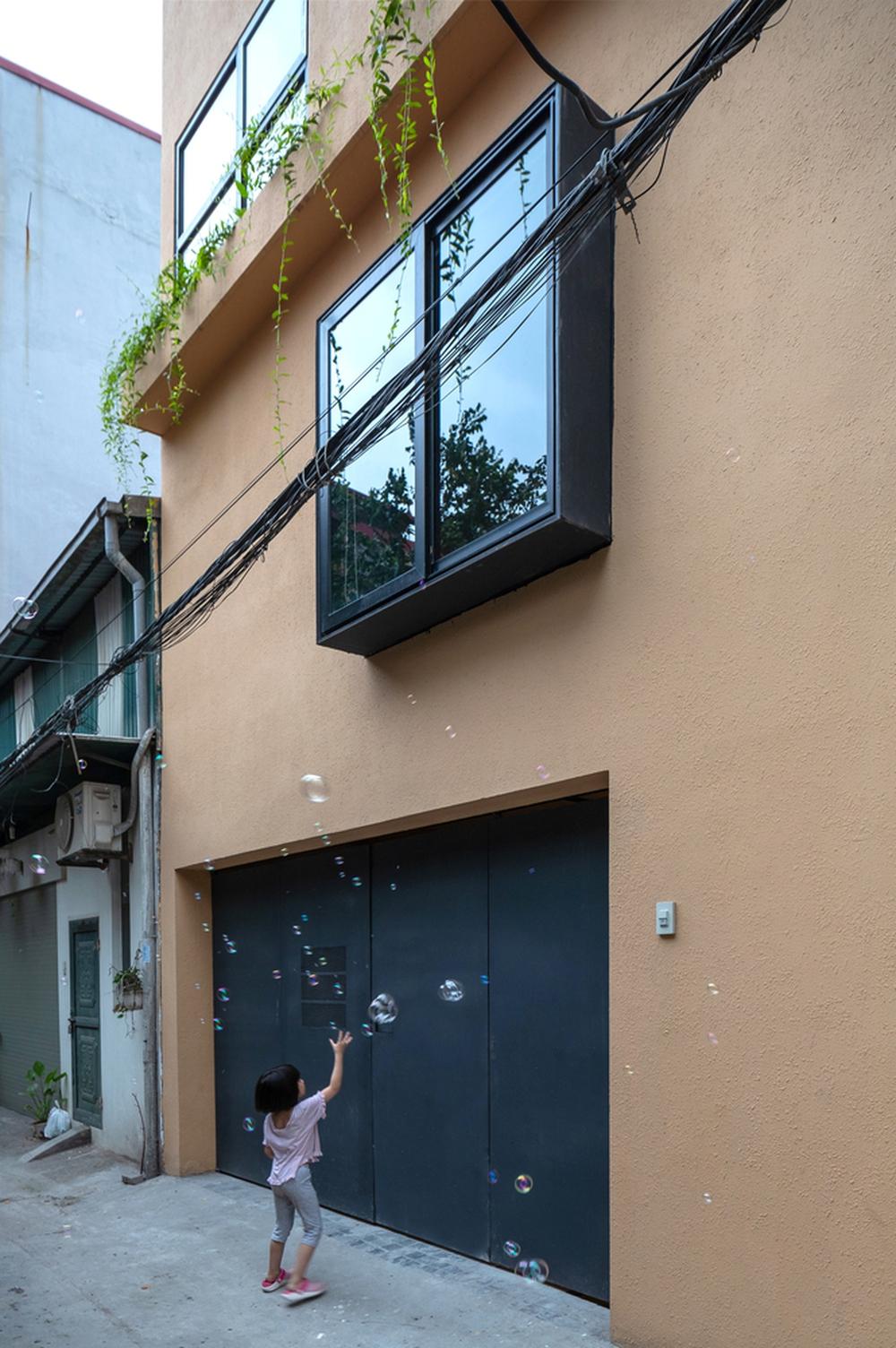 Chiêm ngưỡng ngôi nhà với thiết kế tinh giản đầy mê hoặc ở Trâu Quỳ - Ảnh 8.