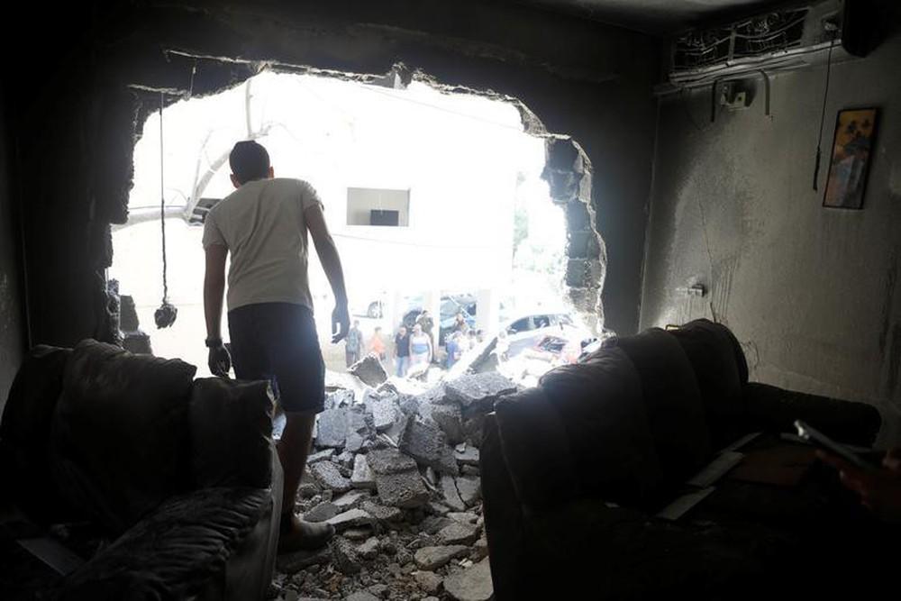 Hứng 2.000 quả rocket của Hamas, vùng biên Israel hóa thị trấn ma - Ảnh 9.