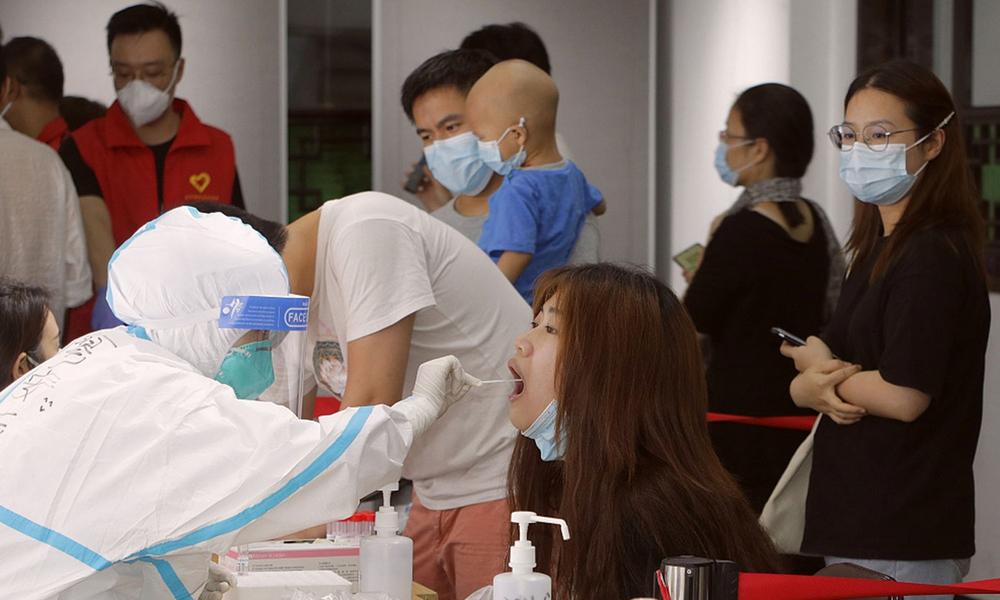 Thành phố Trung Quốc tổ chức đợt xét nghiệm lớn nhất thế giới sau khi COVID-19 lây lan đáng báo động - Ảnh 1.