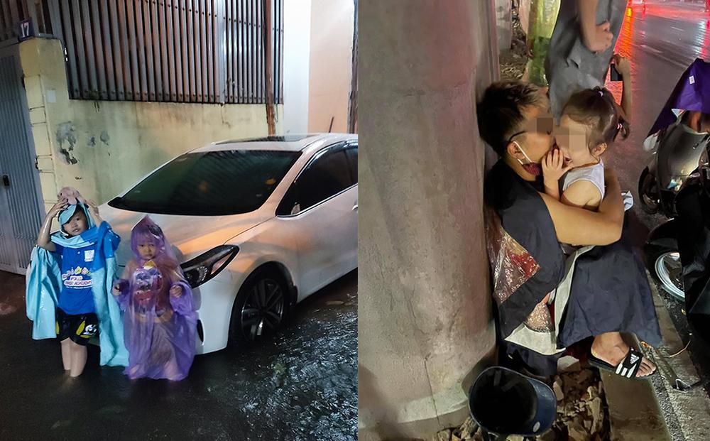 """Giữa trận mưa lớn ở Hà Nội, 2 đứa trẻ có hành động khiến tất cả thất kinh, ông bố bị """"ném đá"""" dữ dội"""