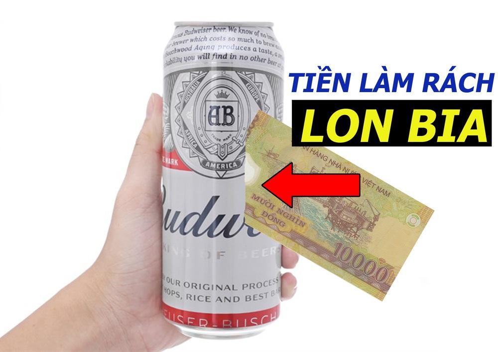 Làm thế nào để rạch lon bia chỉ với tờ tiền mệnh giá 10.000 VNĐ? - Ảnh 1.