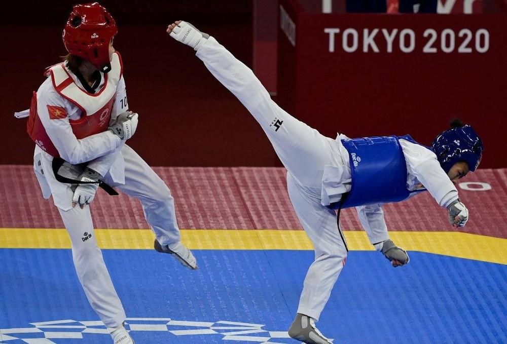 Áp đảo toàn diện đối thủ, võ sĩ Việt Nam đụng độ người Thái tại tứ kết Olympic - Ảnh 1.