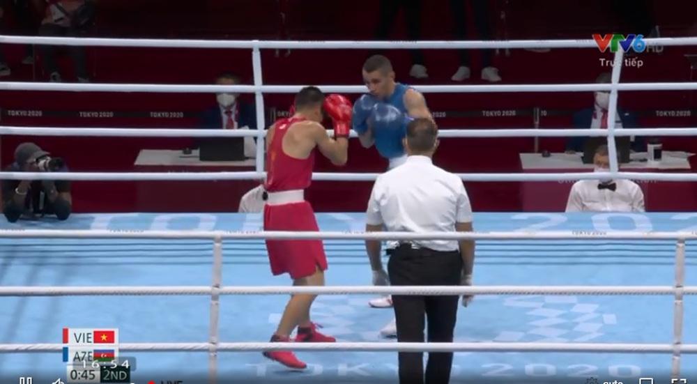 Võ sĩ Việt Nam thắng nghẹt thở trong sự ngỡ ngàng của đối thủ ở Olympic - Ảnh 1.