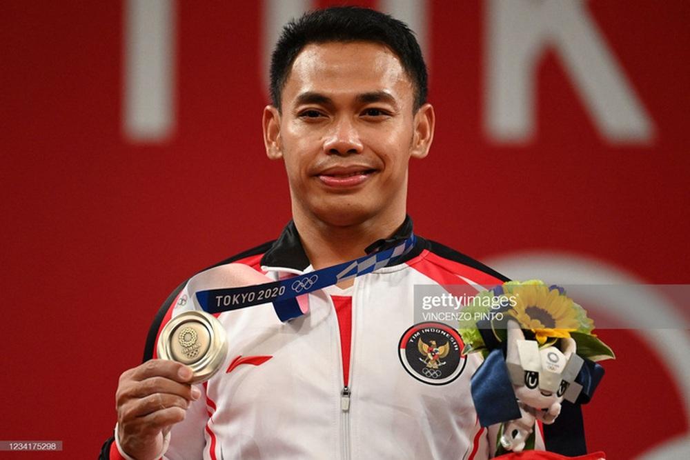 VĐV Indonesia lập 2 kỷ lục khó phá vỡ ở Đông Nam Á sau khi giành HCB Olympic Tokyo 2020 - Ảnh 1.