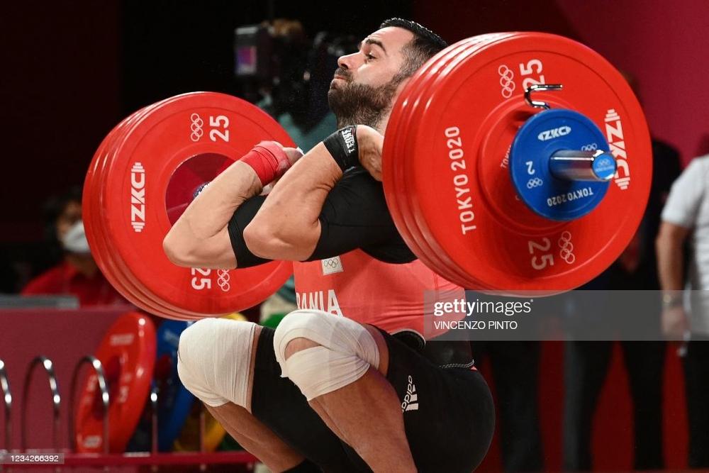 Olympic chứng kiến phần thi tài gây sốc, lực sĩ ĐNÁ tạo kỳ tích khiến tất cả choáng váng - Ảnh 3.