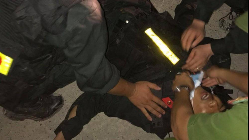 Vụ 5 cảnh sát bị thương: Bắt tạm giam 4 người - Ảnh 2.