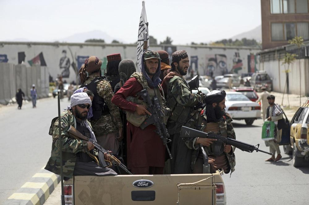 Bắc Kinh phát tín hiệu hỗ trợ Taliban: Chiến lược áp sát kiểu cây gậy và củ cà rốt có hiệu quả như mong đợi? - Ảnh 1.