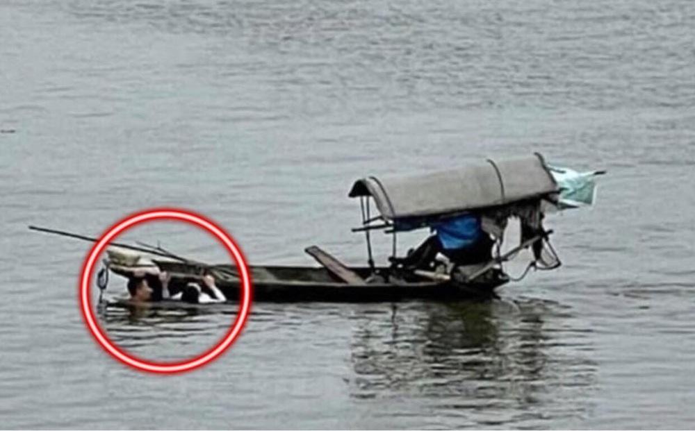 """Thót tim xem clip người đàn ông bơi như rái cá giải cứu cô gái giữa sông, danh tính của anh được tiết lộ còn """"gây sốc"""" hơn"""