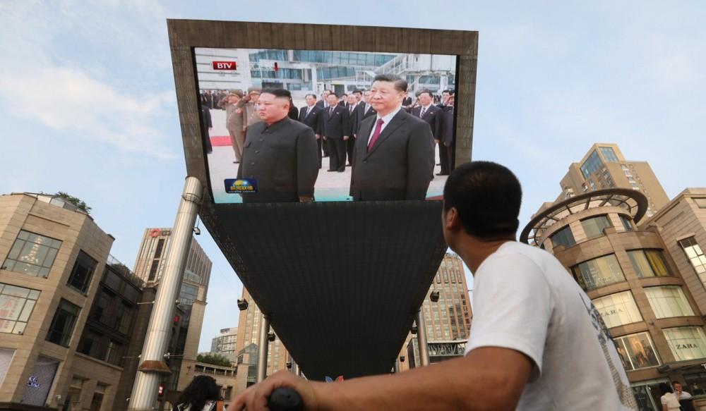 """Được 250.000 người dân Triều Tiên ra đón, Chủ tịch Tập Cận Bình cảm thấy như """"người một nhà"""" - Ảnh 5."""